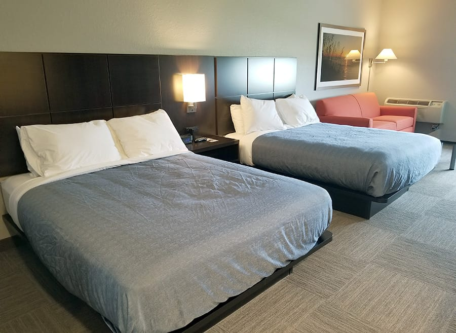 Hotel room remodel, carpet squares, espresso wood headboard, modern furnishings, custom artwork, Hom Furniture at 7 Clans Casino and Hotel in Thief River Falls. MN Casino - Julkowski inc.