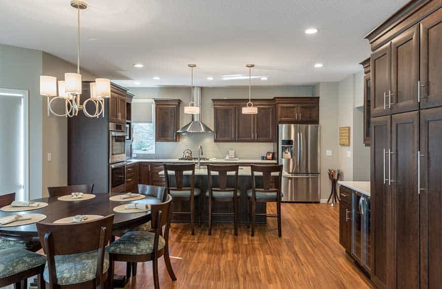 Brooklyn Park Minnesota Renovation - Kitchen remodel, cherry cabinets, luxury vinyl flooring, Cambria counter tops, new mill work, main level renovation - Julkowski inc.