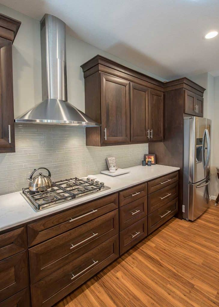 Brooklyn Park Minnesota Renovation - Kitchen remodel, cherry cabinets, luxury vinyl flooring, Cambria counter tops, gas cook top, glass tile back splash - Julkowski inc.