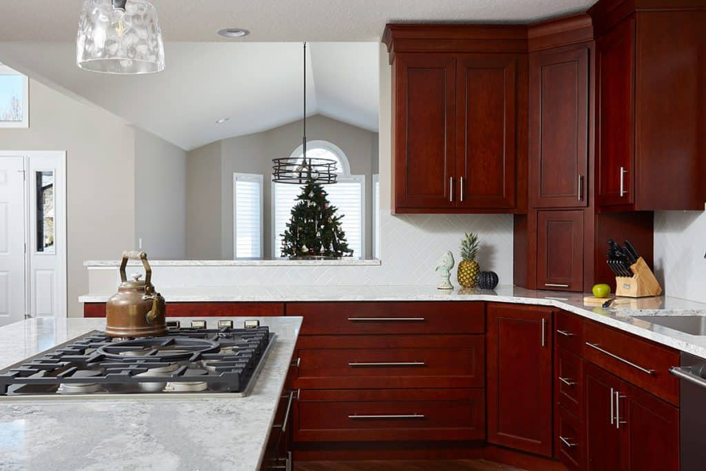 Woodbury Minnesota Renovation - Kitchen remodel, cherry cabinets, Cambria countertops, luxury vinyl flooring, new mill work, guest entertaining bar, main level renovation - Julkowski inc.
