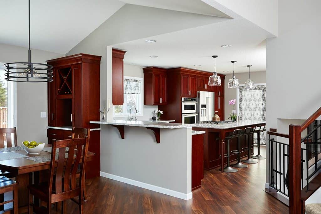 Opened wall to connect the kitchen to the dining & living rooms. A breakfast counter and custom built-in bar create great places for family & friends to hang out.