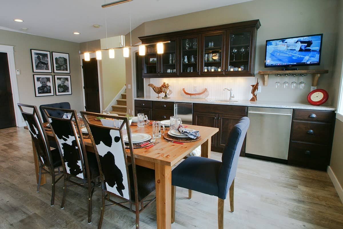 Columbus Minnesota Renovation - Lower level remodel, custom bar, luxury vinyl flooring, cowhide chairs - Julkowski inc.