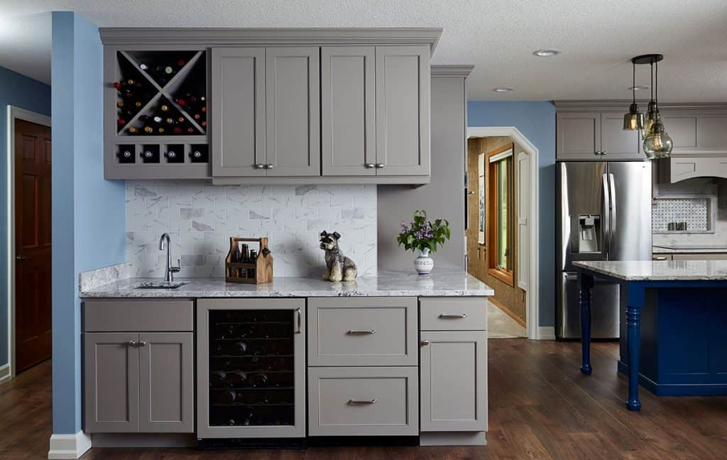 Walls were opened up to create this guest entertaining bar that wraps around the end of the kitchen.