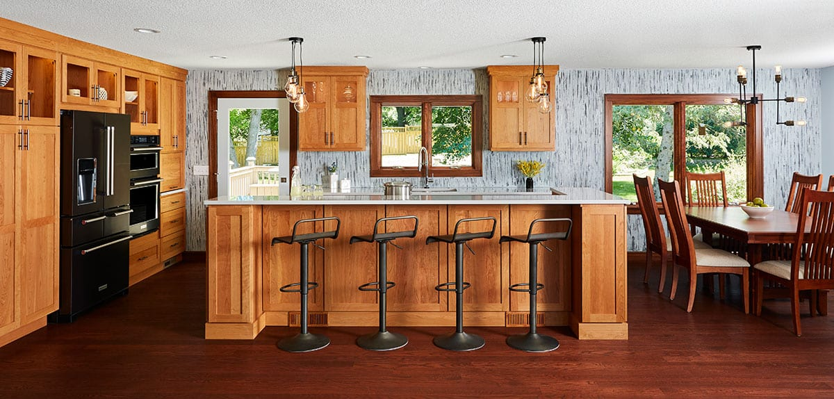 Kitchen & Main Level Renovation in Roseville, MN featuring cherry cabinets, Cambria countertops, & custom painted wall treatment.