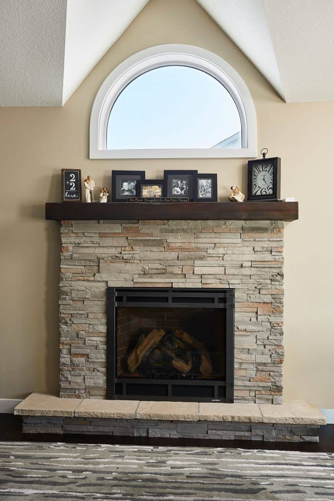 Lino Lakes Minnesota Renovation - Gas fireplace, stone surround, reclaimed mantel, living room remodel - Julkowski inc.