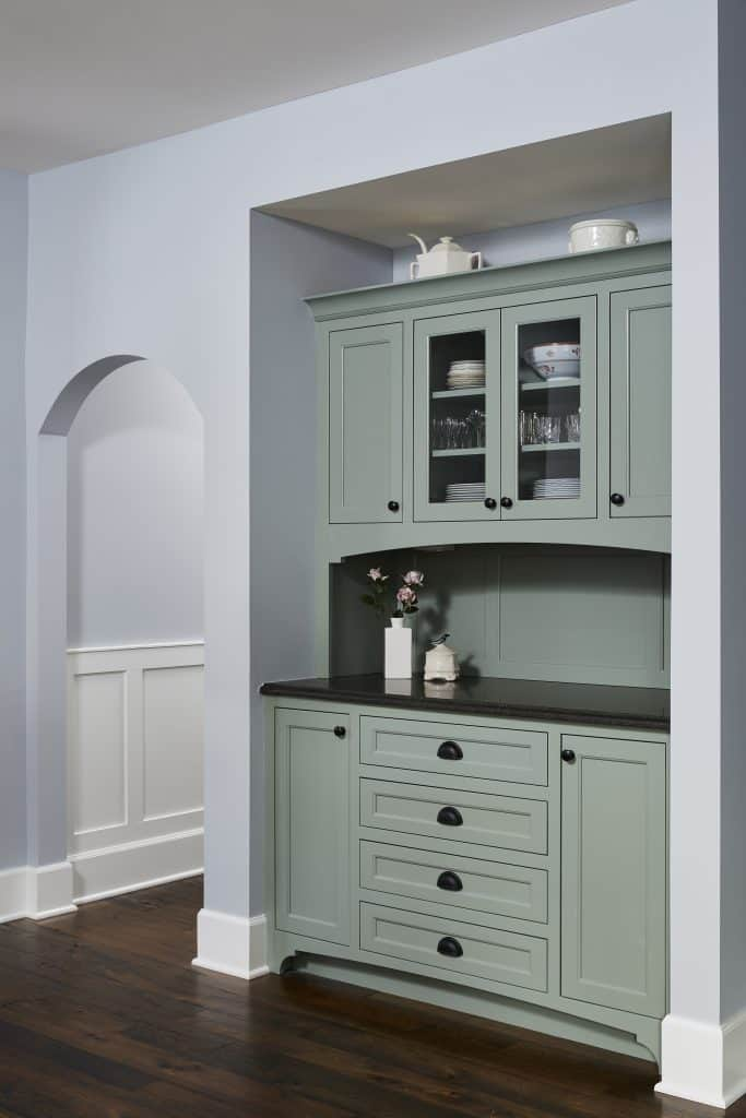 Custom dining hutch in a beautiful sea-green color. Glass doors for display and extra counter space very handy for entertaining.