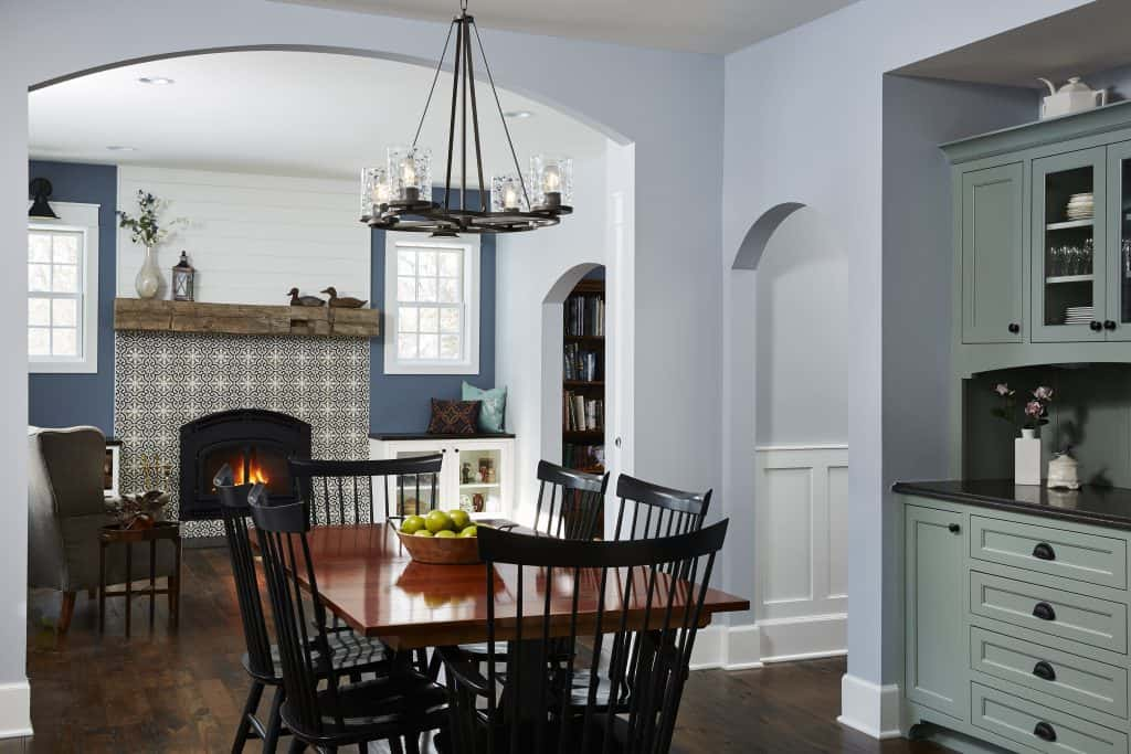 Arched openings connect dining & living spaces. Antique elm flooring and wood burning fireplace.