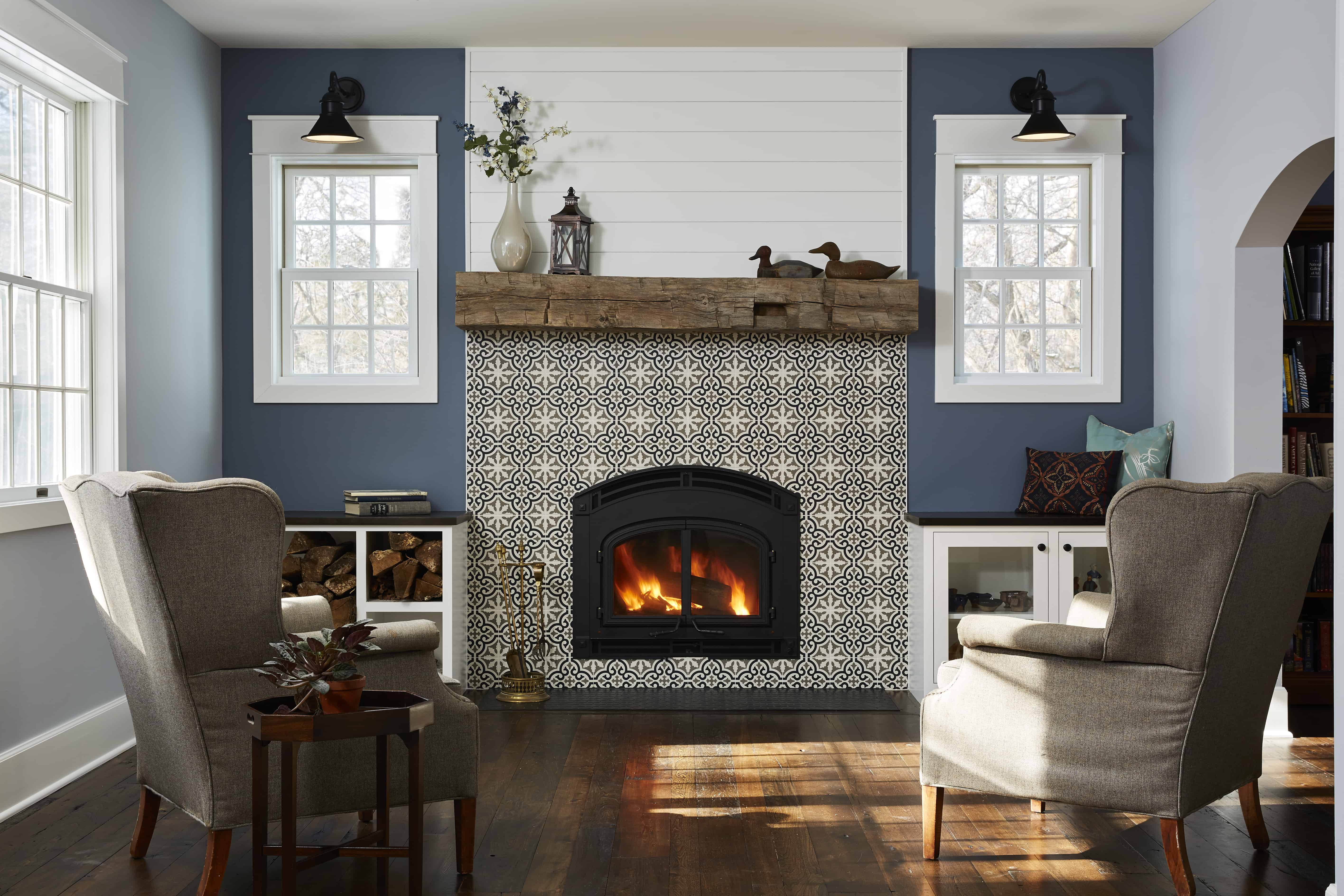 Wood burning fireplace; mosaic tile; antique elm floors; reclaimed mantel; Marvin windows; custom cabinetry; built-ins
