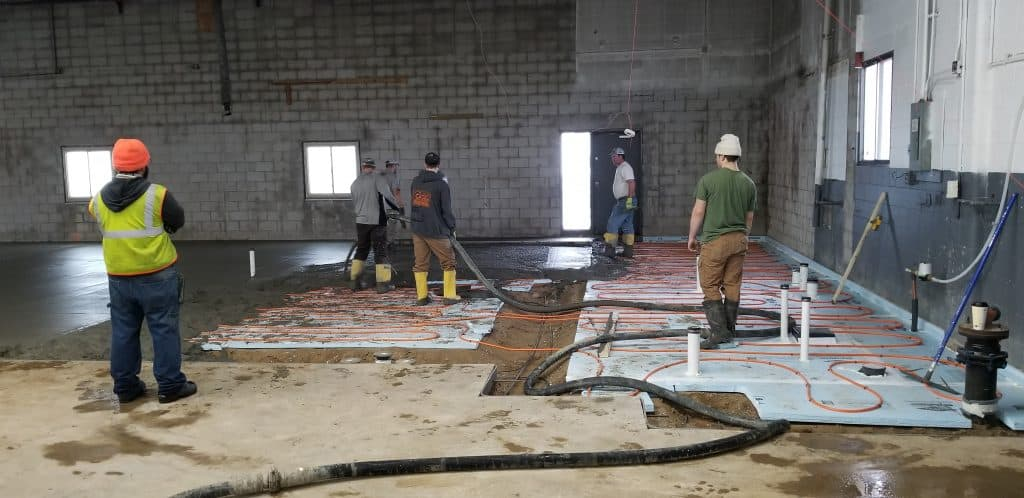 Pouring new floor in showroom Julkowsi inc mn