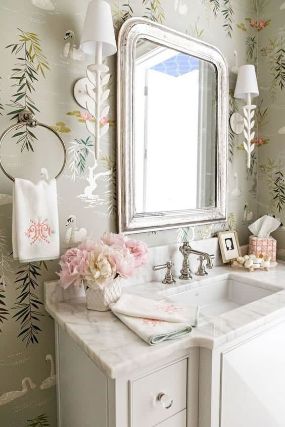 powder room with pink and wallpaper