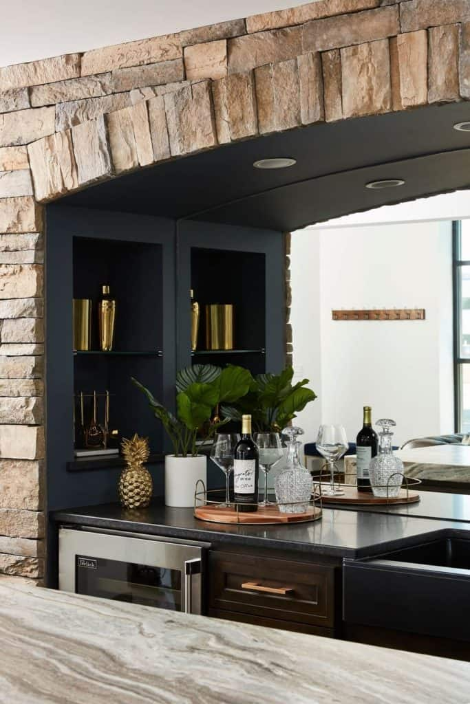 Stone arch and built in cabinetry