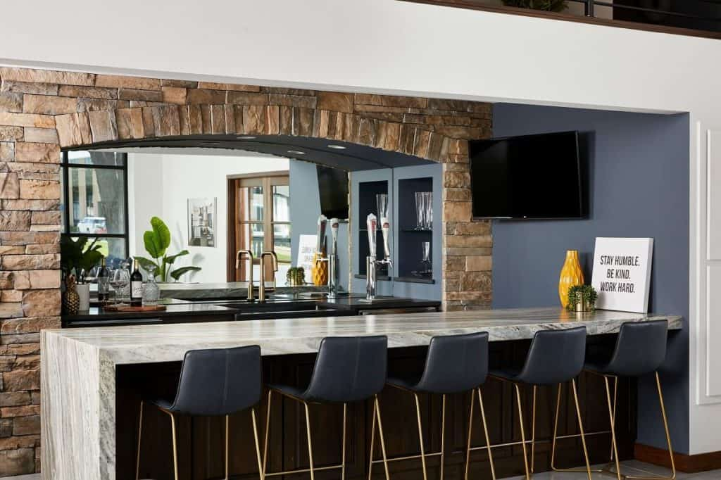 Peninsula with bar seating and stone accents