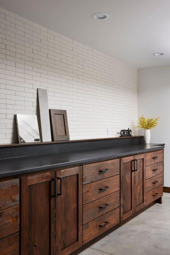 Stained cabinetry and tile wall